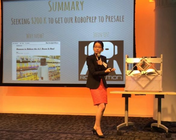 Mei Chai Zheng, graduate student in Electrical Engineering, pitches the Robolution food preparation and cooking device at Demo Day in New York in early August. Click on the photo for more information.