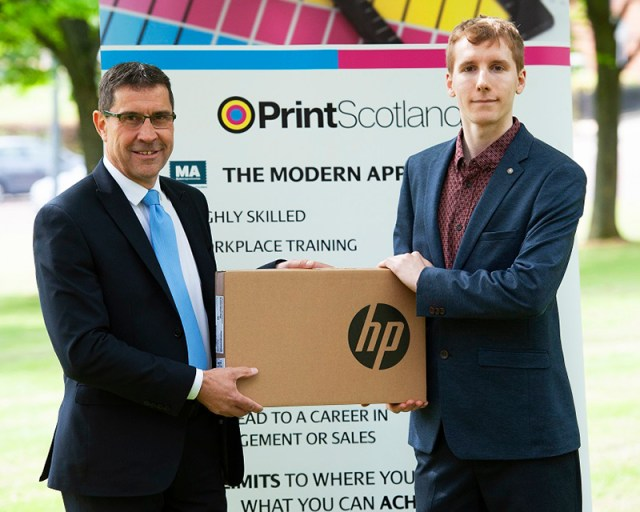 Print Scotland apprentice winner James McCredie on right with award sponsor Joe Chuchla from Muller Martini