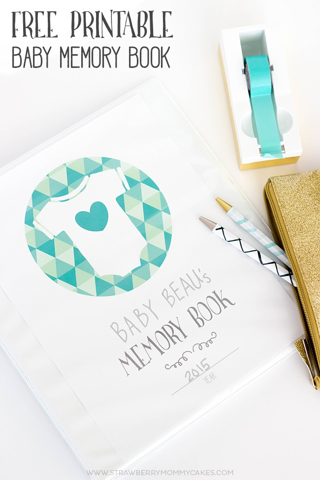 Baby memory book on white table with gold stapler, pens and teal tape