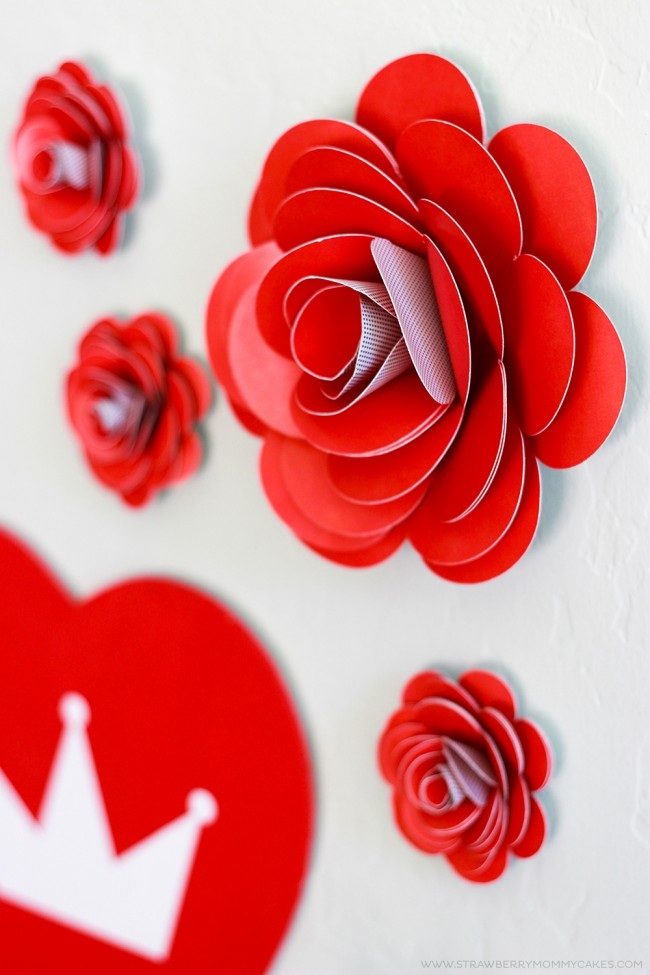 Paper roses on white wall closeup from how to make a paper rose tutorial