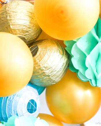 Need a gorgeous statement piece for your next party? Learn how to make this DIY Balloon Garland...it's easier than you think!