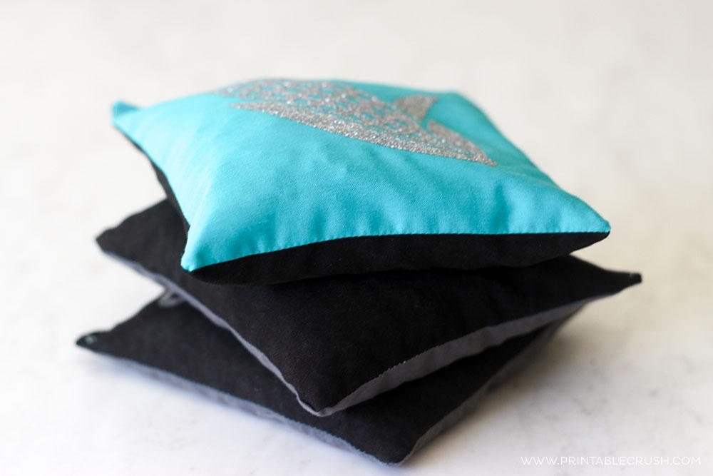 Black and teal DIY Cornhole Bags closeup