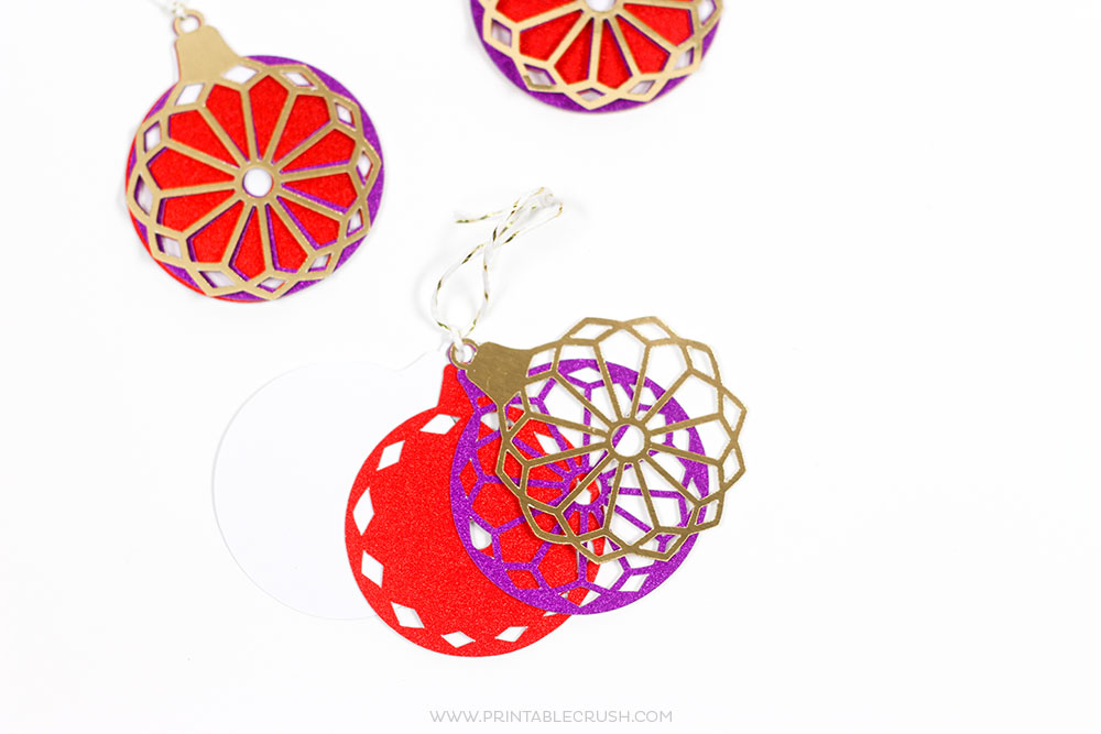 Use theseHandmade Cricut Christmas Gift Decorating Ideas to wrap a perfectly beautiful present! These can also double as Christmas Ornaments!