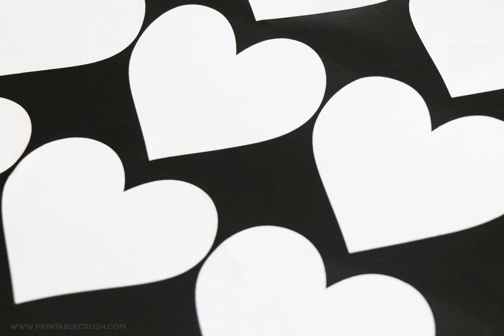 Heart Shapes cut out of Cricut vinyl for a Faux Heart Wallpaper tutorial