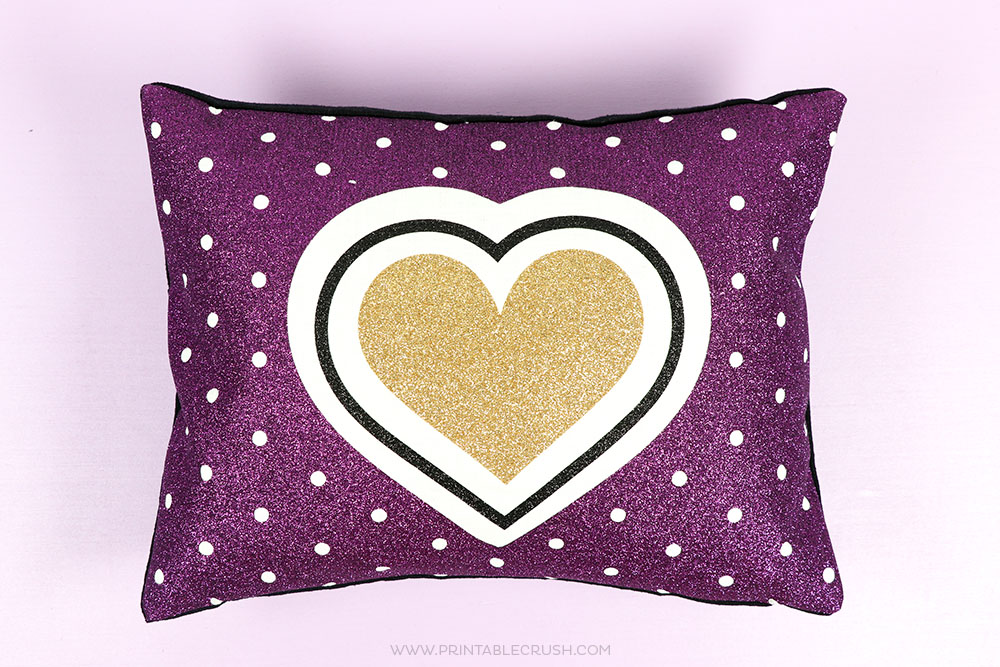 Super fun glitter iron on throw pillows made with the Cricut EasyPress 2