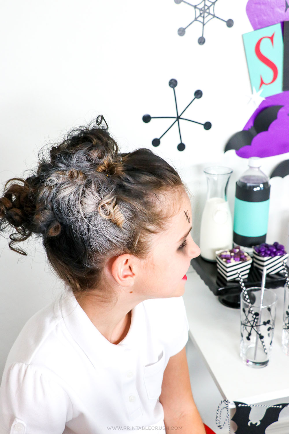 Stick some eighties style rollers in your daughters hair and add some colored hairspray for a Bride of Frankenstein hairstyle!