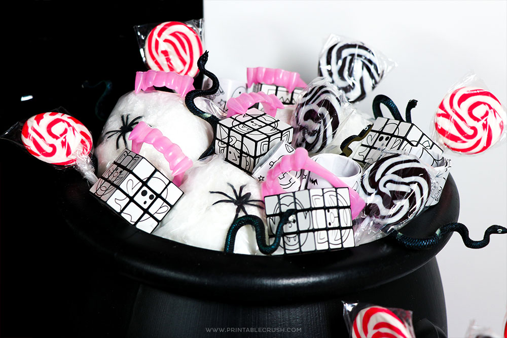 Create a witch's cauldron for Halloween by including candy and non-candy treats