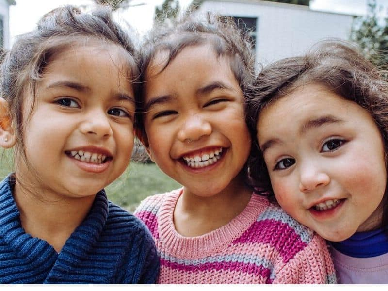 three-smiling-girls-solve-conflicts-with-peers