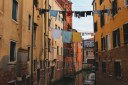 Laundry Drying Above A Canal In Venice
