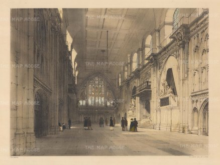 """Guildhall. Interior scene showing Gog and Magog, protectors of the City. """"T.S. Boys"""" is carved a third of the way up the pillar on the left hand side."""