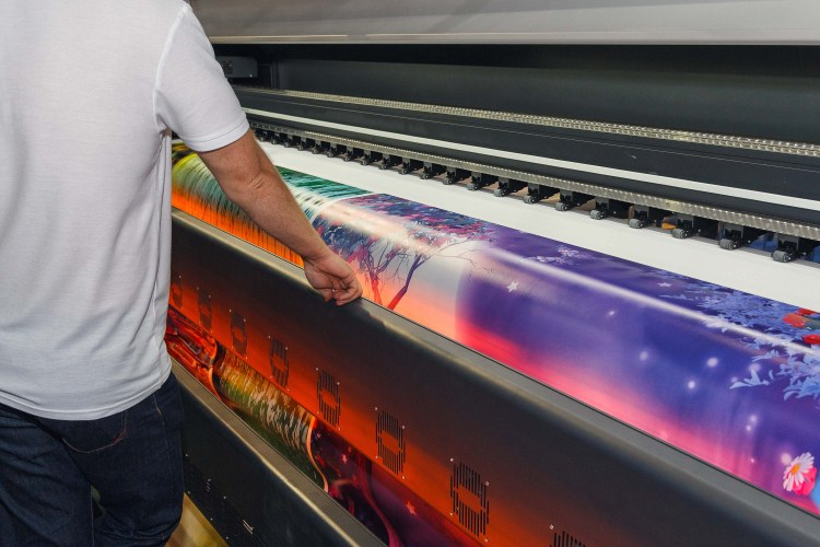 Large-format printing machine in the printing house. Industry