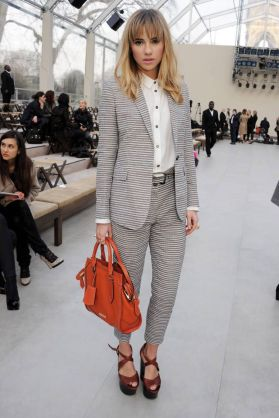 LONDON, ENGLAND - FEBRUARY 18: Suki Waterhouse attends the Burberry Prorsum Autumn Winter 2013 Womenswear Show at Kensington Gardens on February 18, 2013 in London, England. (Photo by Dave M. Benett/Getty Images for Burberry)