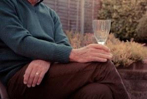 Older man holding cup