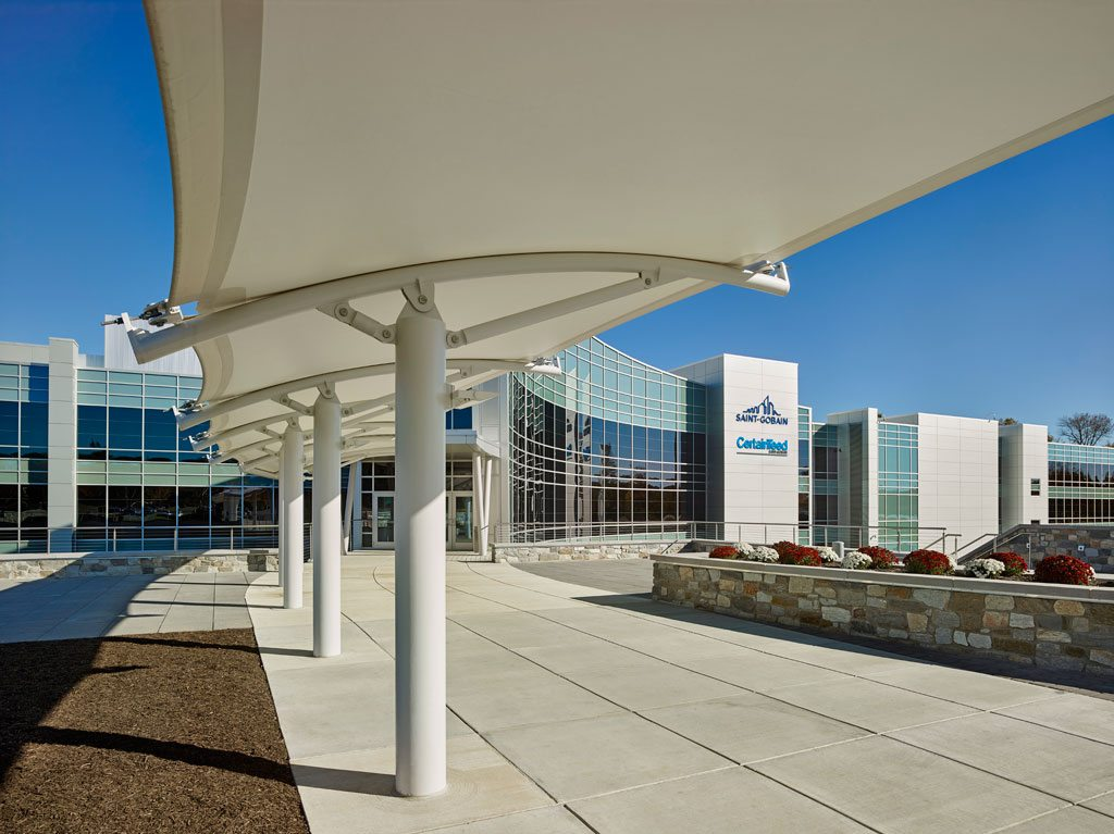 Pictured here is Sheerfill® Fiberglass Architectural Membrane coated with TeflonTM which was installed to create a canopy over the entranceway of the headquarters. Sheerfill is used in many of the world's landmarks for its contribution to valuable LEED® points and its lowering of air conditioning and lighting costs. It has the potential to transmit up to 17 percent of daylight with long-term reflectivity of over 70 percent. It is also the first architectural membrane to be rated by the Cool Roof Rating Council and is ENERGY STAR® certified. Sheerfill was selected for the headquarters of parent company Saint-Gobain for its maintenance-free attributes, over 25-year life expectancy and its noncombustible features. In addition, the product was selected to create a stunning architectural profile that can be appreciated day or night. Photo: © Jeffrey Totaro