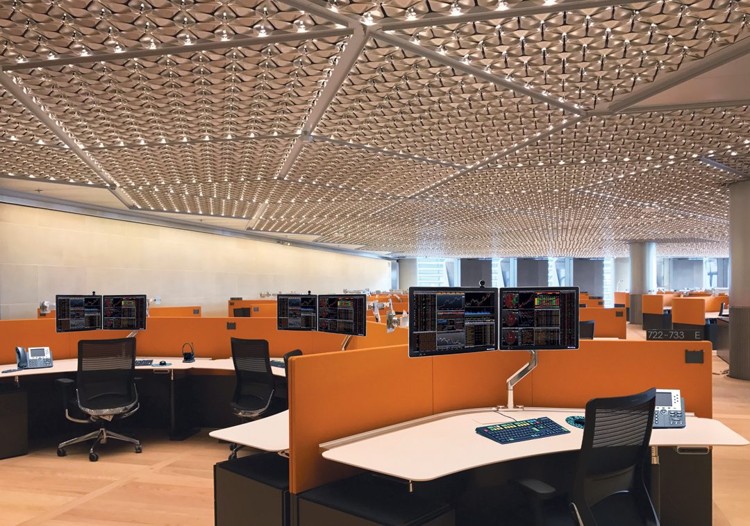 Bespoke integrated ceiling panels combine heating, cooling, lighting and accoustic functions in an innovative petal-leaf design. Credit: 'Bloomberg'