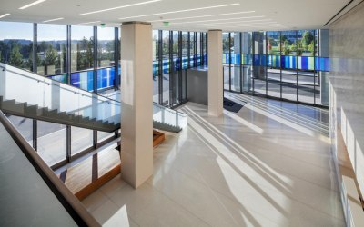 Goldray's laminated pattern on Starphire glass showcases colorful corporate design trend