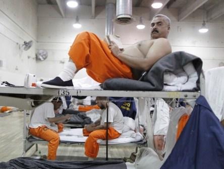 prisoner reading book - takepart.com