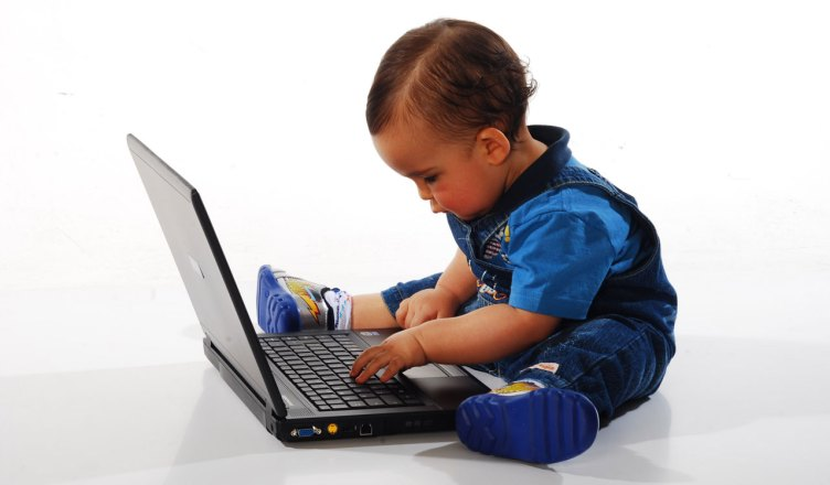 child at laptop computer
