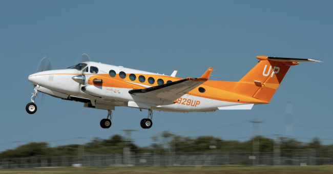 Wheels Up Feeding American Orange King Air 350i