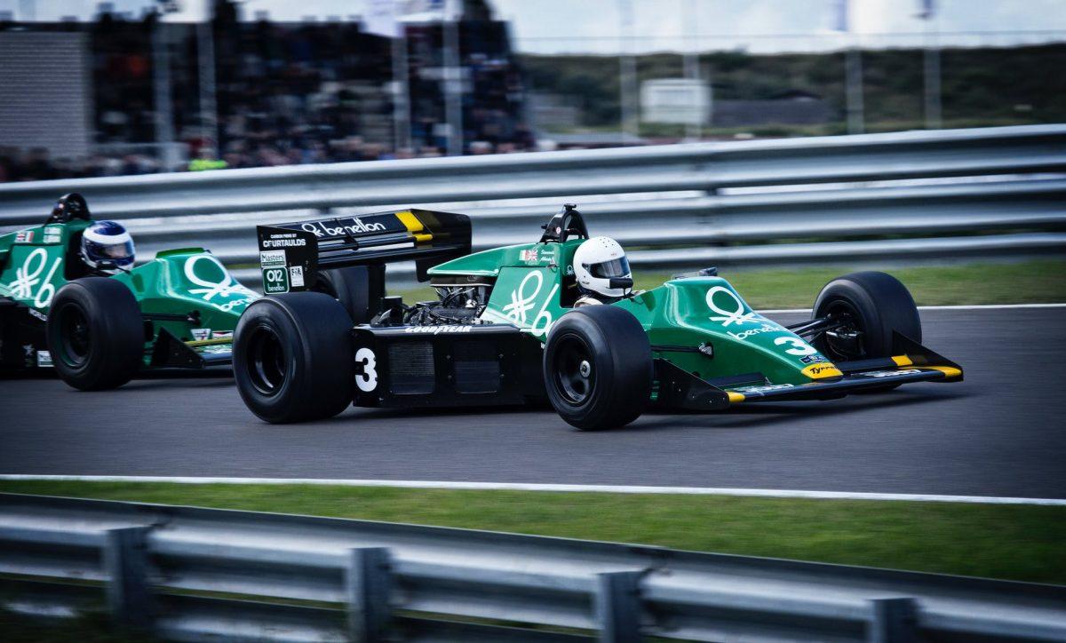 man riding on racing car