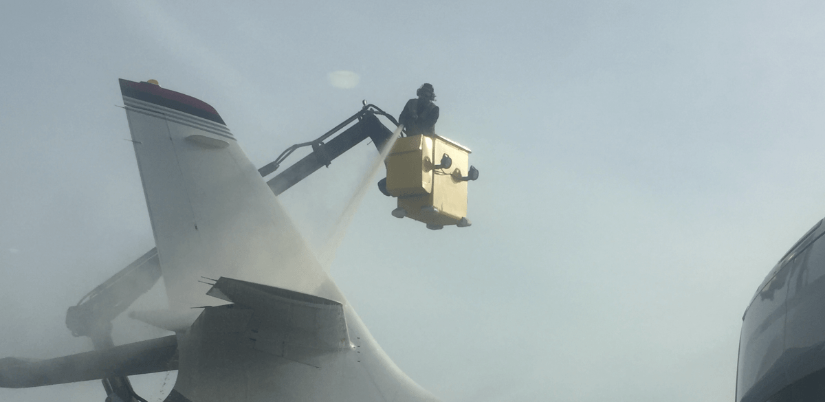 private jet being de-iced