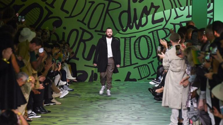 Dior menswear designer Kim Jones taking his bow on the runway printed with Shawn