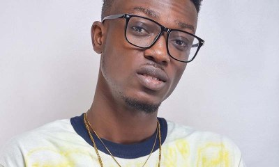 Dadie Opanka in a spectacle with chains on his neck