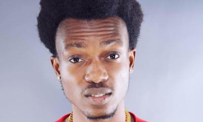 Dadie Opanka in a red shirt wearing a chain necklace