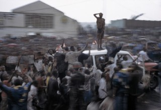 Residents of the town of Goma in eastern DRC salute Laurent Kabila after his army took control, displacing the Mobutu forces.