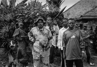 Mai Mai general Vita Katembola, surrounded by his bodyguards at their base near Beni, northeastern DRC. At the time this group was allied to a rebel...