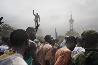 A statue of Patrice Lumumba erected by Laurent Kabila, and an unfinished tower built during the Mobutu years, look down on Jean-Pierre Bemba...