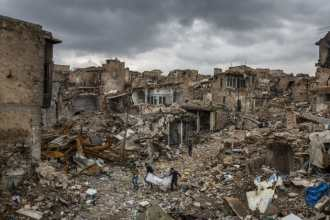 A group of volunteers work to collect unclaimed bodies, most of them suspected of being those of ISIS members, from the ruins of the Old City...