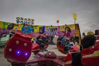 Young couples enjoy a ride at a newly reopened theme park on the banks of the river Tigris in east Mosul. After ISIS, life is coming back to the city...