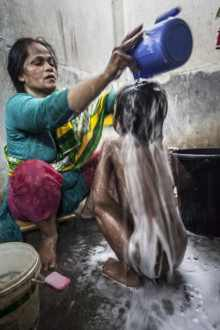 Hajera bathes the younger children of the orphanage, 2014