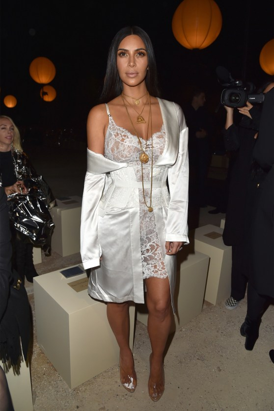 Kimmy in Givenchy slip dress and robe during Paris Fashion week in 2016. No kidding!