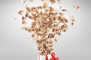 Money exploding out of a gift box