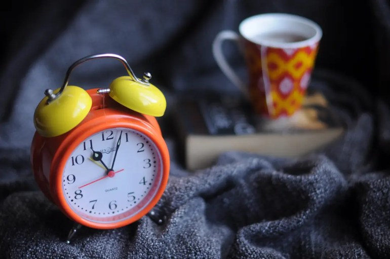 Clock, coffee and book —Set regular hours to read and actually enjoy reading.