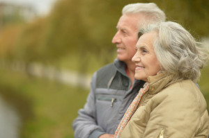 42189222 - elderly couple smilling together over natural background