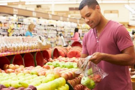 42270308 - man at fruit counter in supermarket