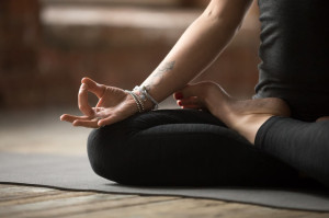 Young woman doing Lotus exercise, mudra gesture close up