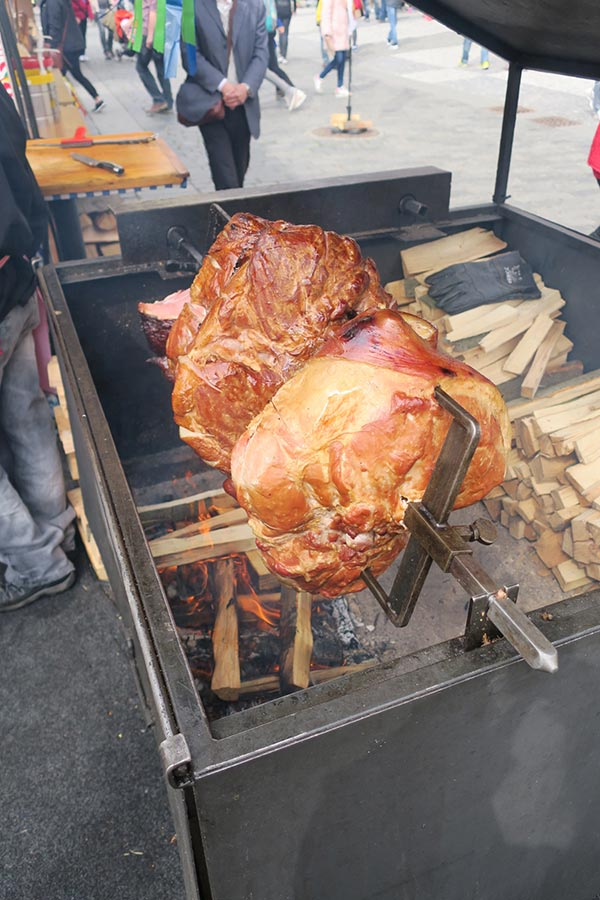 Ham turing on a spit at Prague Easter Markets