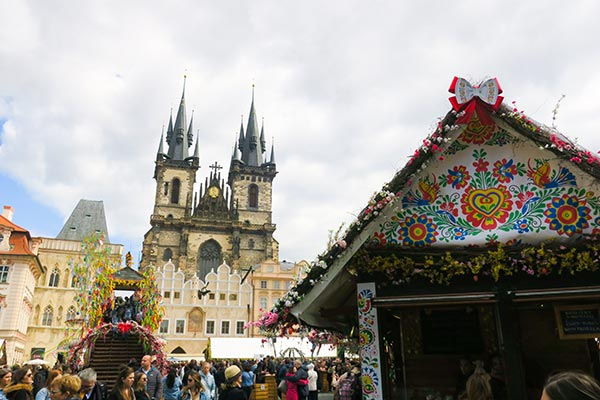 Prague Old Town Square with Prague Easter Market booth in the foreground