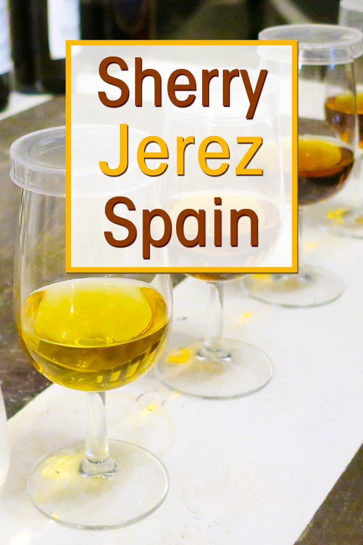 Glasses of different sherry wine displayed for the sherry tasting tour in Jerez de la Frontera. With text overlay: Sherry Jerez Spain