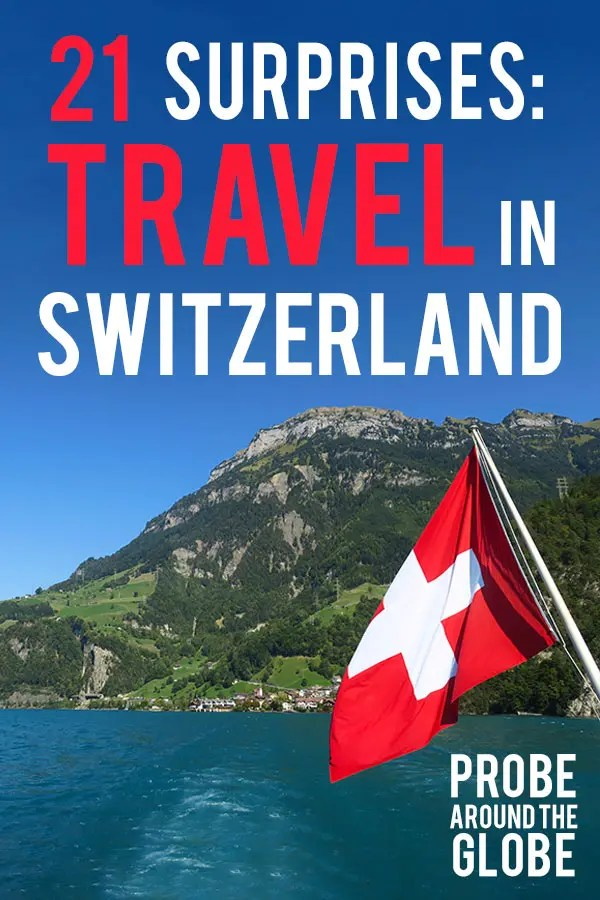 Image from a boat of Lake Luzern with flag of Switzerland with text overlay saying: 21 surprises: travel in Switzerland, Probe around the Globe