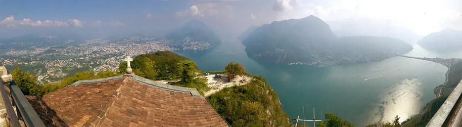 Panoramic view of Lugano from San Salvatore mountain overlooking the Lake Lugano, one of the best places in Switzerland to visit if you can.