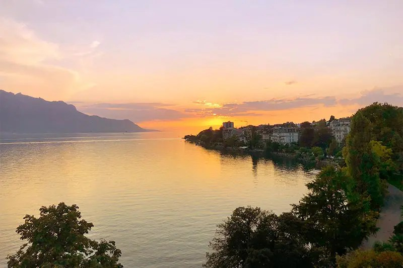 Lovely sun set from the balcony of our hotel in Montreux, one of the best cities in Switzerland to visit year round.
