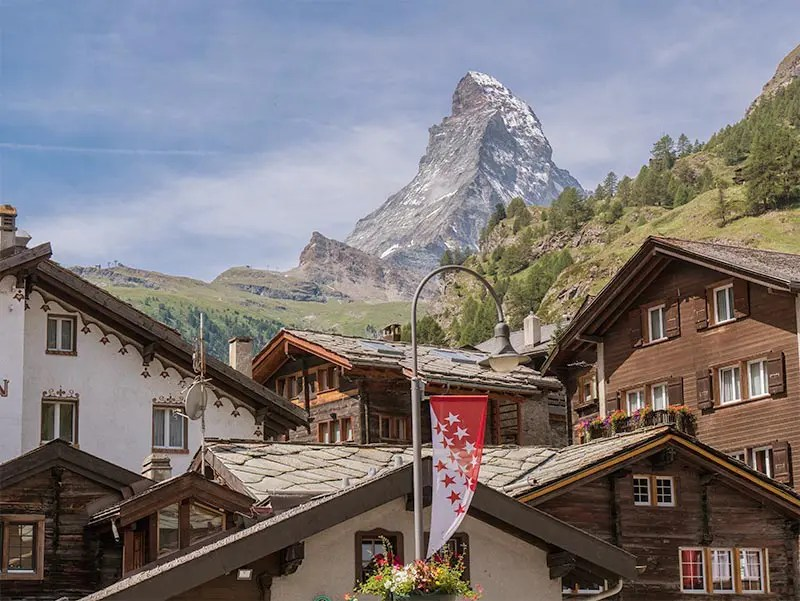 Wooden cabins in Zermatt with views of the Matterhorn Mountain in Switzerland.