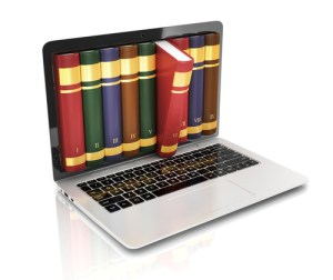 A laptop with books - Internet research