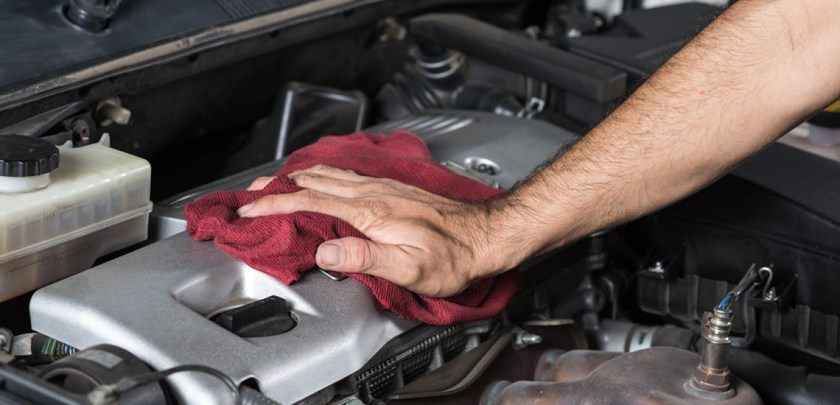 Auto Mechanic Cleaning Car Engine