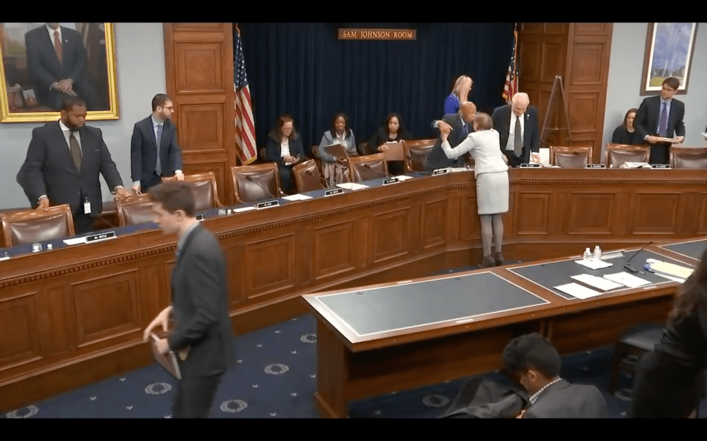 Hon. John Lewis and Nina Olson embrace following her testimony on March 7, 2019.